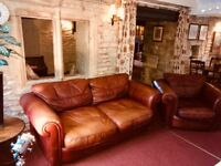 Brown leather Chesterfield sofa and matching armchair