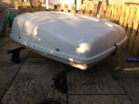 Karrite roof box. Good and strong. Missing keys. Works fine. Some rust on bar clasps.