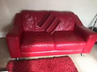 Red leather sofas DFS with red table and rug