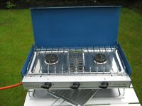 CAMPING COOKER it has 2 BURNERS and a GRILL, IT IS IN VERY GOOD USED CONDITION, it is ideal for