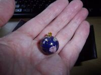 Two new boxed 14ct gold globes ( pendants ), £100 for one or £175 the pair. Swindon