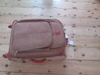 Four wheel Suede Look Bermuda Suitcase by itluggage many holiday pockets & zips - USED ONLY ONCE