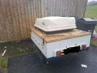 Camping trailer and roof box
