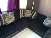 Large black cuddle chair and corner sofa