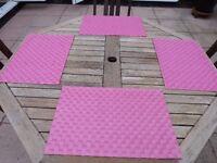 Four pink place mats