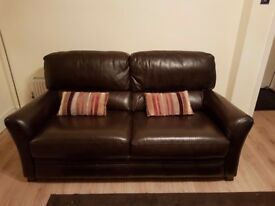 Brown leather two seater sofa and two armchairs