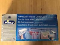 Retractable indoor clothes line (new in box)