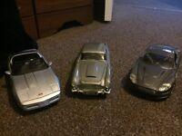 three james bond metal handmade cars