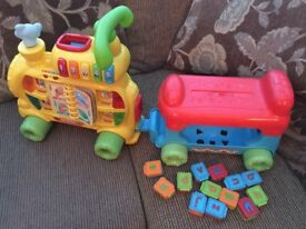 Toddler toy train to sit on and push along