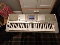 Yamaha PSR-2100 Keyboard. 61 full-size keys with touch response.