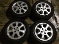 vauxhall alloys 16 inch 4 stud with good tyres 50 pound