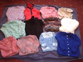 assortment of twelve beautifully hand knitted children's cardigans various sizes