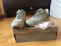 Pale blue Asics trainers