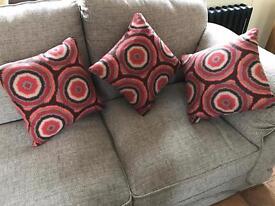Three Orange and Brown Pillows