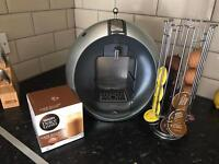 Dolce gusto coffee machine with pods and pod holder
