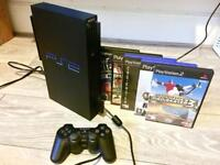 Sony PlayStation 2 PS2 with games (Tony Hawk Pro Skater 3)