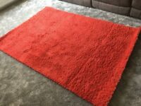 Nearly new Ikea red rug.