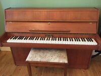 Beautiful Zender upright piano & stool in Teak, with music included