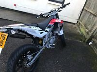 Aprilia SX 50cc. Full power with Arrow exhaust system. Super reliable and Very fast Supermoto.