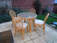 Daro Round Glass topped Dining Table & 4 cushioned Dining chairs