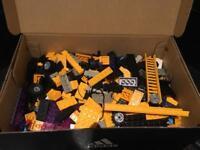 Box full of building bricks like Lego but not