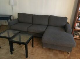 A large brown/grey sofa with a right-hand chaise corner module, Finnish design and manufacture
