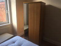 2 Lovely Oak Veneer Wardrobes with Mirrored door. Happy to sell individually