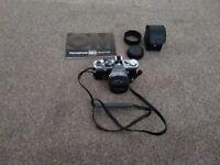 Olympus OM2 SLR camera with manual