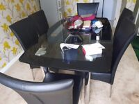 Italian Black double Glass table with 6 leather chairs(From Furniture Village)