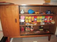 Solid Teak bookcase, sliding glass doors, in excellent condition