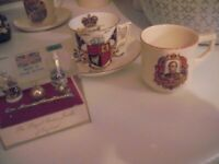 Sovereign cups and saucer and display of crown jewels.