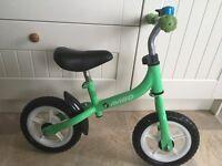 Green balance bike aged 3+