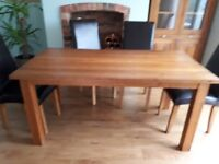 Oak table & 4 dark brown leather chairs. Plus matching oak & glass cabinet