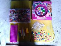 Lots of loombands and accessories including s and c clips and charms