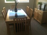 Dining room table with 3 granite inserts, 6 chairs and a matching sideboard with 1 granite insert.