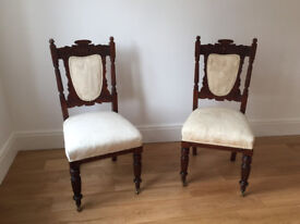 A pair of carved wood chairs
