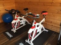 Two commercial grade spinning bikes, fully serviced with no rust. Cost £400 each new