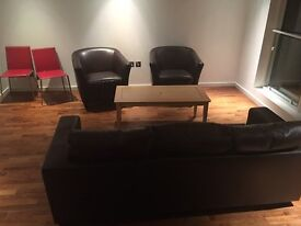 for sale - brown leather and two arm chairs - £100
