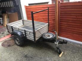 Metal trailer with spare wheel