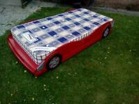 Single bed red motorcar and mattress