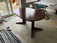 Free to collect. Solid oval extendable table with six matching chairs, qualitity piece, minor W&T.