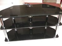 Chrome and smoked black glass three tier TV stand. Excellent Condition