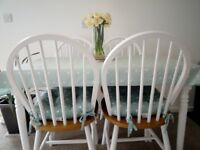 Kitchen table and four matching chairs, excellent condition. Forced sale due to moving house.