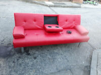 red leather sofa bed with built in speakers blue tooth ,phone adapter,memory card