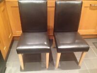 Six leather effect chairs
