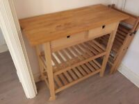 kitchen wooden table with wheels perfect for barbecues