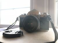 Nikon F2 (comes with warranty) perfect condition and shoots perfectly!!!!!