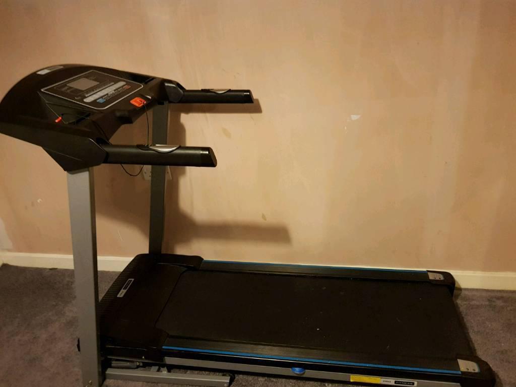 Treadmill, motorised incline