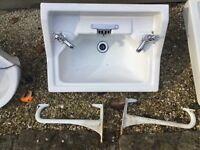 Substantial sink with original support brackets.