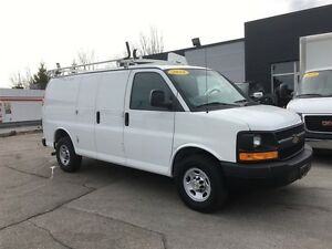 2014 Chevrolet Express 2500 cab divider, shelving ladder rack.